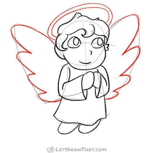 Draw the angel's wings and halo