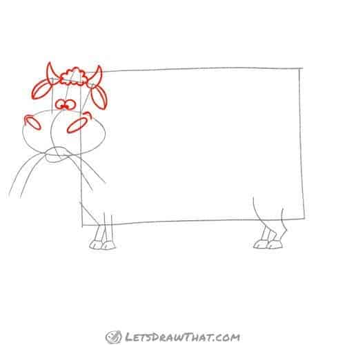 Drawing step: Draw the cow's head features