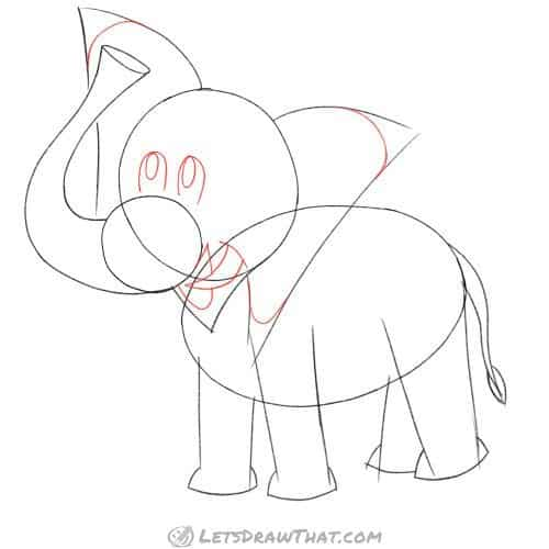 Drawing step: Round off the ears, and sketch the eyes, mouth and tusk