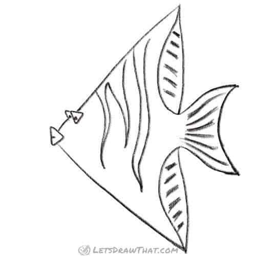 How to draw a fish from triangles: completed pencil outline